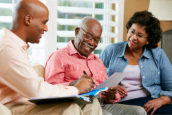 financial advisor talking to the senior couple at home