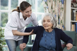 senior assisted by a caregiver